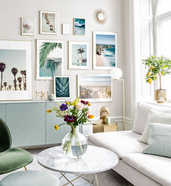 Beautiful gallery wall with summery nature motifs and golden frames