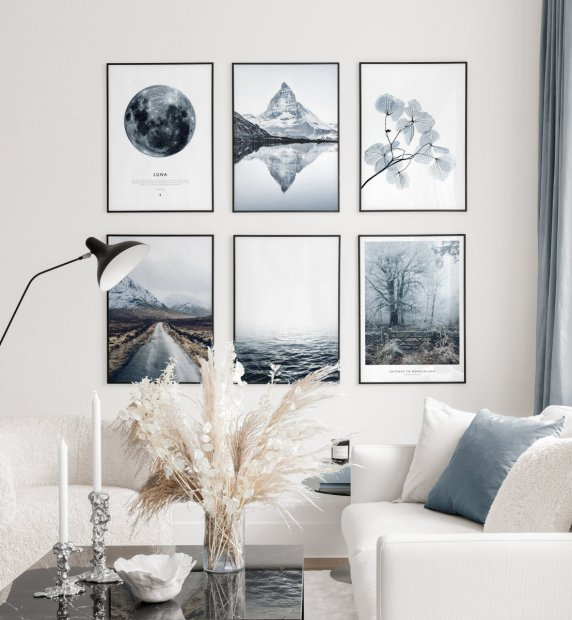 Winterly gallery wall with nature posters in chilly blue colours in black metal frames