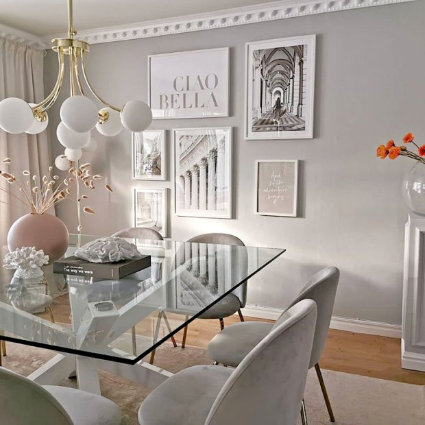 Stylish dining room gallery wall beige kitchen posters