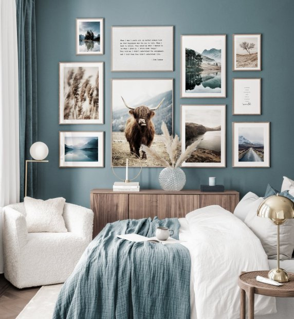 Adventurer gallery wall blue interior nature posters landscapes oaken frames