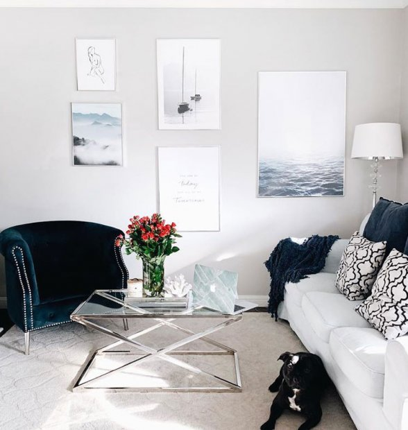Gallery wall in silver frames with nature prints